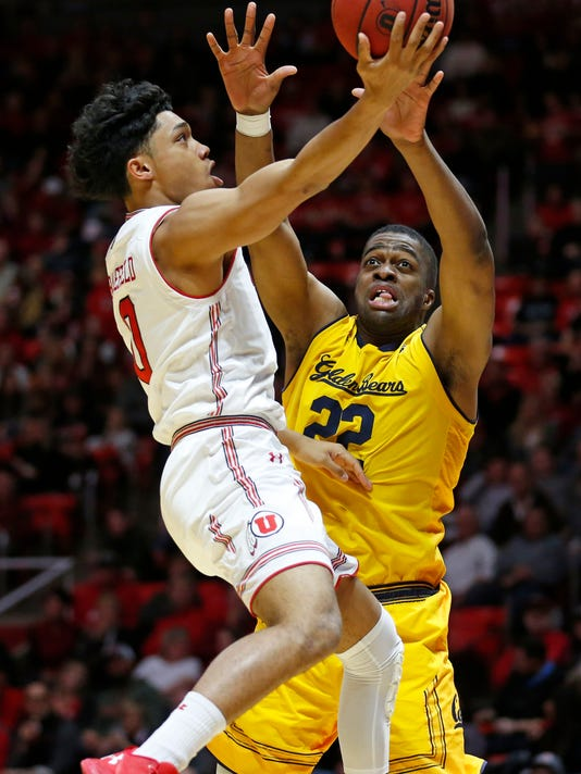 Utah guard Sedrick Barefield, left, lays the ball up as California center Kingsley Okoroh (22) defends during the second half during an NCAA college basketball game Saturday, Feb. 10, 2018, in Salt Lake City. (AP Photo/Rick Bowmer)