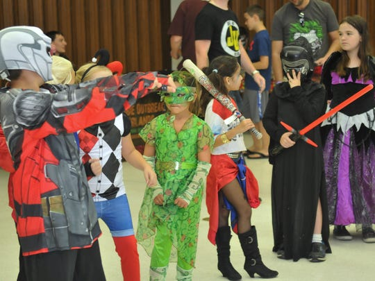 The Melbourne Toy and Comic Con was held Sunday, October 2. Cosplayers, artists, gamers, exhibitors, and fans filled the Melbourne Auditorium.