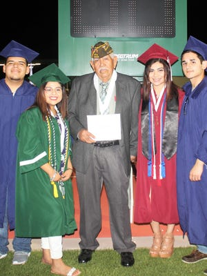 On Saturday, Antonio C. Riojas (center), 86, received his high school diploma during Taft High School's graduation commencement at the Taft Greyhound football stadium. Five of his great-grandchildren also graduated from different high schools this year, including Savannah Hernandez from Calallen High School; Ryan Serrata and Dylan Arciniega from Carroll High School; and Larissa Lopez from Taft High School.