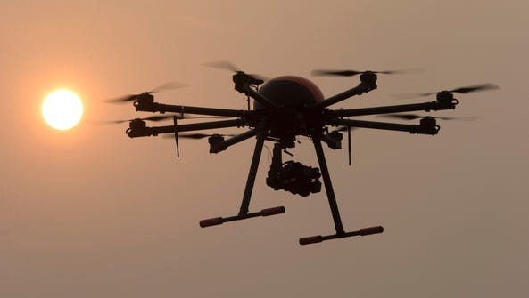 In this Oct. 17, 2015 photo, a drone hovers with the