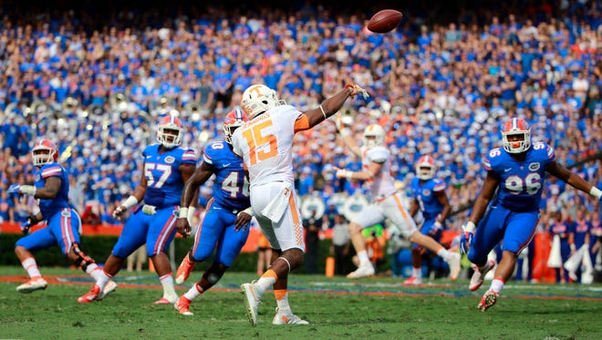 Tennessee receiver Jauan Jennings (15) throws the ball to quarterback Joshua Dobbs (not pictured), who runs it in for a touchdown against Florida during the first quarter on Sept. 26, 2015.
