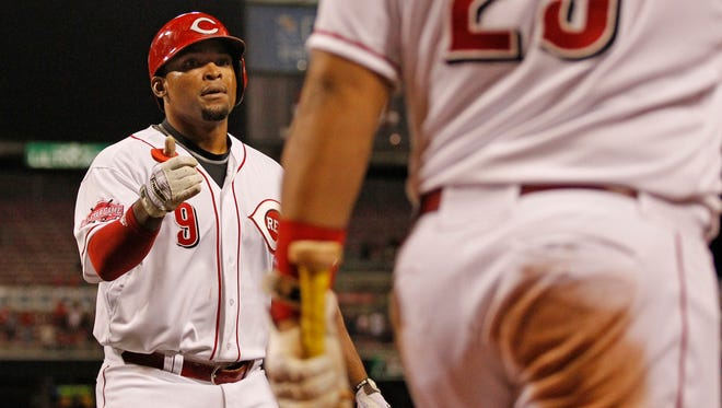 Reds left fielder Marlon Byrd returns to the dugout after his home run to left field during the bottom of the eighth inning Thursday against the Giants.