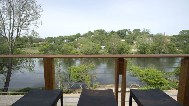 New Belgium's tasting room in West Asheville includes a spacious deck with a view of the French Broad River.