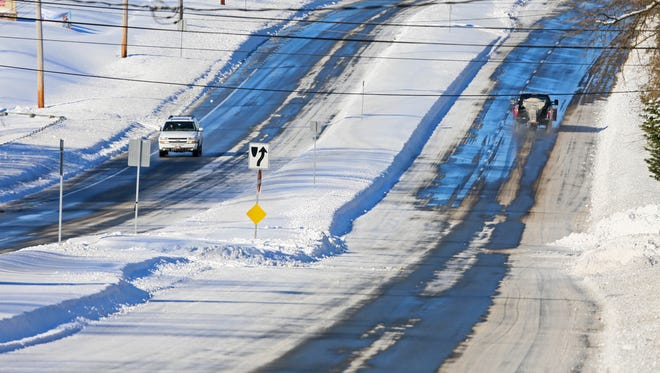 Some vehicles were out on Lancaster Pike near Route 141 Sunday morning.