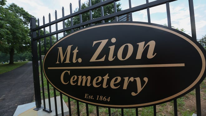 A new sign and fence welcomes visitors at the Mt. Zion Cemetery near Wilmington.