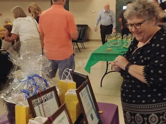 Celia Ruben checks out the raffle prizes at Cape Coral