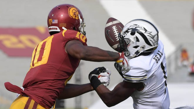 Western Michigan Broncos defensive back Sam Beal (1) intercepts a pass intended for Southern California Trojans wide receiver Jalen Greene (10) during a NCAA football game at Los Angeles Memorial Coliseum. USC defeated Western Michigan 49-31.
