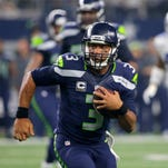 Seattle Seahawks' Russell Wilson (3) runs the ball late in the second half of an NFL football game against the Dallas Cowboys, Sunday, Nov. 1, 2015, in Arlington, Texas.