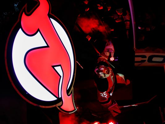 New Jersey Devils goalie Cory Schneider takes the ice prior to an NHL hockey game against the Ottawa Senators, Thursday, Feb. 16, 2017, in Newark, N.J. (AP Photo/Julio Cortez)