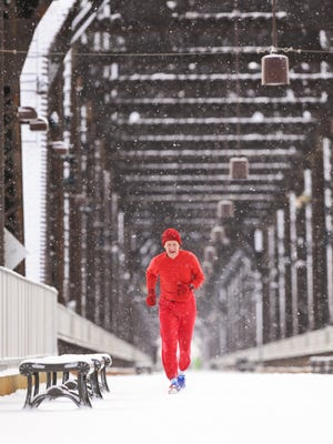 """Matt Stone/Courier-JournalJerry Barber, 71, runs on the Big Four Bridge on Thursday morning. Barber has been running for 48 years and often runs barefoot.Jerry Barber gets a run in on the Big Four Bridge during Thursday morning's snow. The 71-year-old has been running for 48 years, and often runs barefoot because """"it brings back childhood memories."""" If I felt better at 21 I don't remember, he said with a laugh. """"Pain, if it is anticipated, chosen and managed, is one of the best teachers we have,"""" the church minister said."""