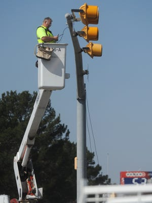 A city of Abilene employee is working on the traffic lights at Grape Street and North 1st Street Monday, Feb. 27, 2017.
