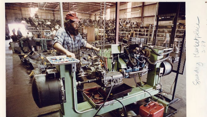 Jerry Sherron of Aaron's Transmission tests a transmission on a test stand in March of 1983.