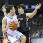 Holy Cross' Tyler Bezold keeps Dixie's Tyler Schreck from driving to the basket.