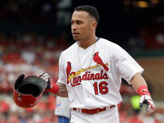 FILE - In this Sept. 14, 2016, file photo, St. Louis Cardinals' Kolten Wong drops his helmet after grounding out to end the eighth inning of a baseball game against the Chicago Cubs, in St. Louis. Wong caused a stir late in spring training when he said he'd rather be traded than be a platoon player. Despite not starting in the season opener, Wong now says he's on board with however he can help the Cardinals return to the playoffs _ even if that means sharing time with Jedd Gyorko.(AP Photo/Jeff Roberson, File)