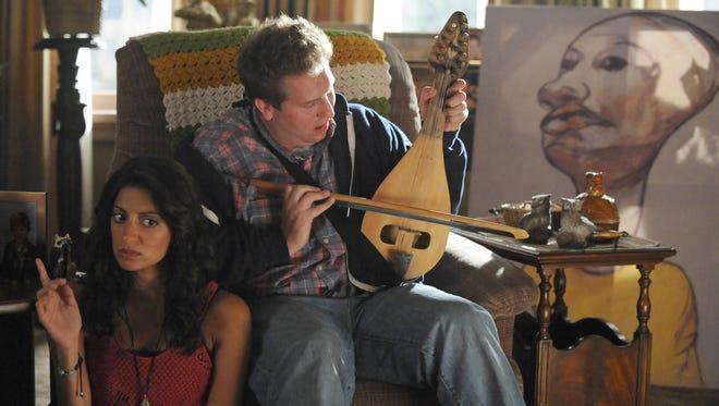 Zard (Meera Rohit Khumbhani) and Eric (Nate Torrence) play  new neighbors and friends in Fox's 'Weird Loners.'