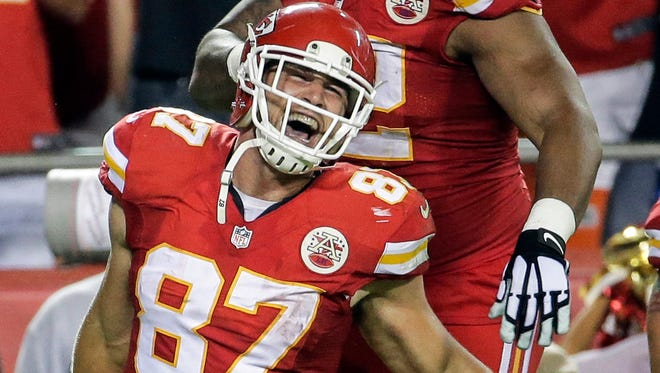 Kansas City Chiefs tight end Travis Kelce (87) celebrates a touchdown catch against the New England Patriots on Monday, Sept. 29, 2014, in Kansas City, Mo.