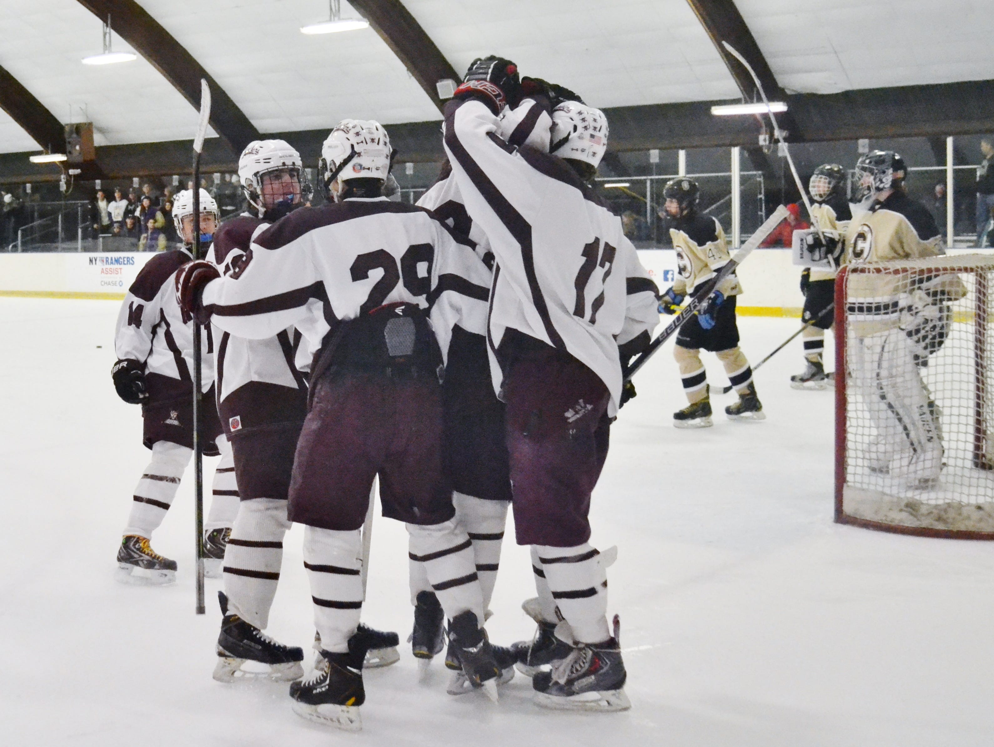 Scarsdale forward Jonathan Schwartz (29) is congratulated after scoring to give the Raiders a 2-0 lead in Sunday's win over Clarkstown.