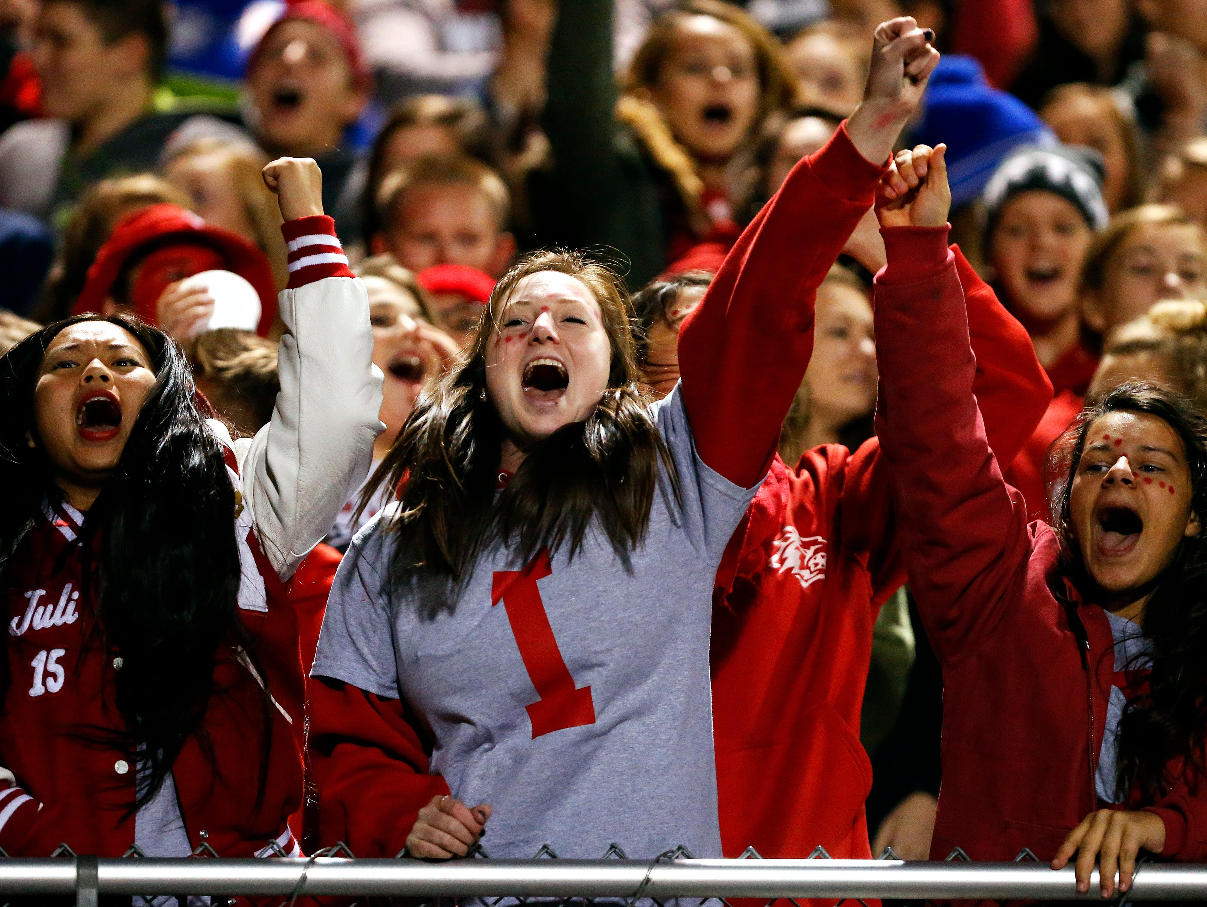 Reeds Spring High School fans cheer after a score during first quarter action of the Wolves' game against Central High School at Carl Langley Field in Reeds Spring, Mo. on Oct. 9, 2015. Reeds Spring won the game 35-24.