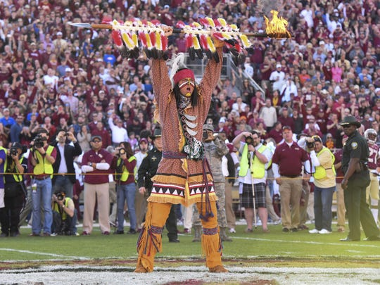 Chief Osceola prepares to plant his spear at midfield
