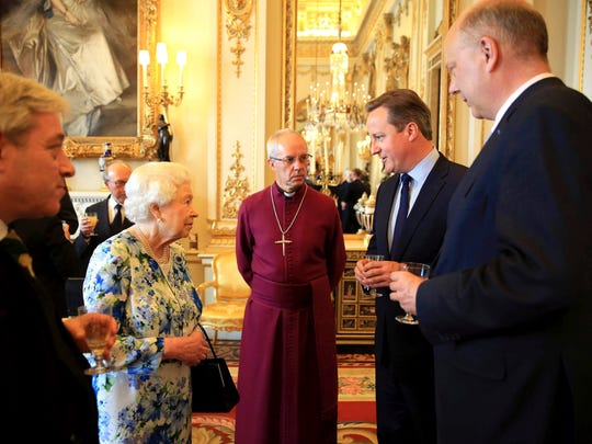 Queen Elizabeth II speaks with Prime Minister David
