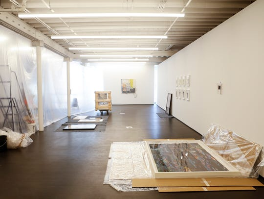 A view of the second floor gallery space where art