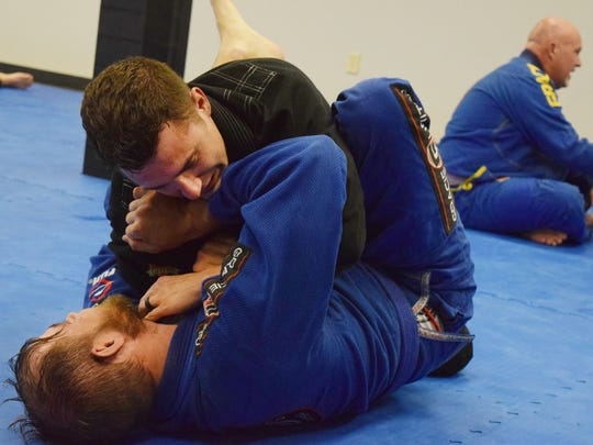 "Alexandria police officer Matthew Voorhies and Eric Jordan ""roll"" in class at Gracie United Alexandria Brazilian Jiu Jitsu. Voorhies has been involved with Brazilian jiu jitsu for seven and half months. ""Jiu Jitsu goes on the principle that the smaller guy could use technique to submit a much larger opponent with leverage,"" said Voorhies who has lean but fit build."