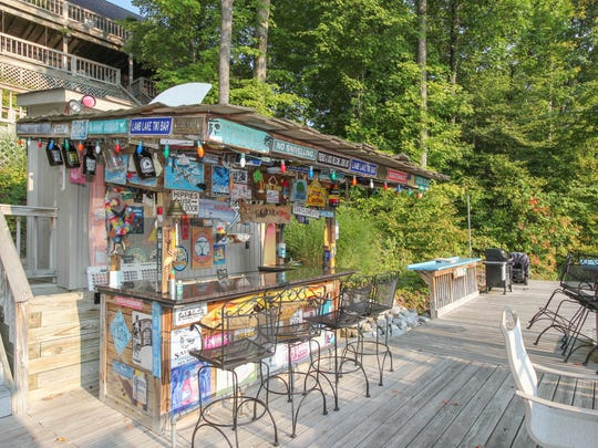 The home at 7511 South Poplar Point Drive comes with a tiki bar on its dock.
