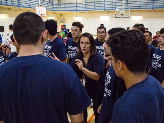 Senior Probation Officer Suzie Hernandez coaches the Kids Team at the annual Kids vs. Badges basketball game, held at the Indio Community Center, Tuesday, August 9, 2016.