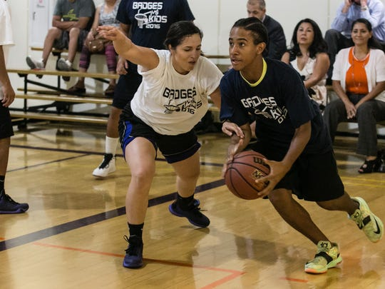 Kids from across the Coachella Valley face off at the Indio Community Center against Riverside County law enforcement in the annual Kids vs. Badges basketball game, Tuesday, August 9, 2016.