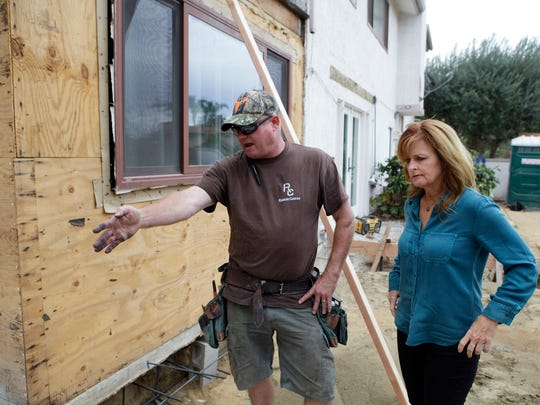 Joe McCormick, left, and Laura Kay Dunbar examine a worksite in Ventura as they do a walk-through recently. Dunbar used the Thrive in Five program to get her contractor's license and expand her business.