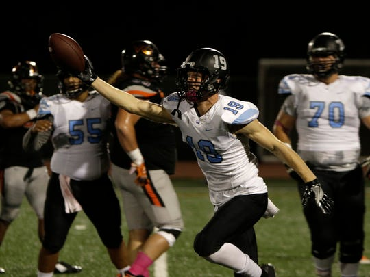 Kade Schmitz of Moorpark College celebrates a touchdown