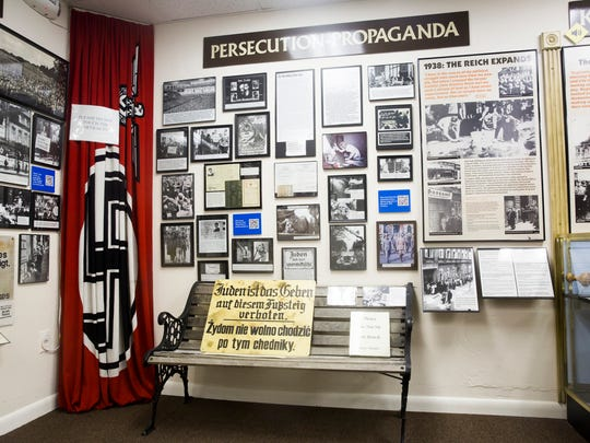 Sections of the Holocaust Museum and Education Center of Southwest Florida display a range of artifacts, from propaganda to military uniforms, on Tuesday, Nov. 22, 2016, in Naples.
