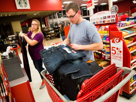 "Haylee Lantz, left, and her brother, Evin Lantz, buy clothing at a Target in the Coral Ridge Mall in Fort Lauderdale, Fla. for their unexpected stay on Friday, January 6, 2016. Their family of 20 adults and a baby did not leave the airport until 8:30 at night after attempting to get home from a cruise. Boutelle and her boyfriend, Evin Lantz, were in the terminal getting food before their flight when the Transportation Security Administration came through, yelling ""run"" with their arms spread."