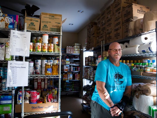"Ray Furman stands in the stockroom at the ""Our Daily Bread"" food pantry at The Family Church of Marco Island on Wednesday, March 22, 2017. The food pantry is open on the second and fourth Saturdays of the month. Furman, now living in Fort Myers, volunteers at the pantry and church."