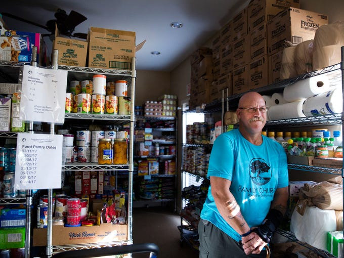 """Ray Furman stands in the stockroom at the """"Our Daily"""