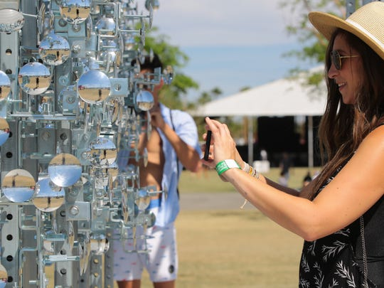 Apr 16, 2017; Indio, CA, USA; Festival-goers take photos in front of Gustavo Prado's art installation during the Coachella Valley Music and Arts Festival at Empire Polo Club. Mandatory Credit: Zoe Meyers/The Desert Sun via USA TODAY NETWORK