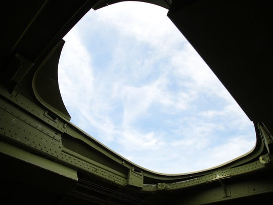 "A view out the roof hatch of a Boeing B-17 ""Flying Fortress"" as it flew over Palm Springs, Calif., Monday, April 24, 2017.  The plane, the Madras Maiden, is one of only 12 B-17 bombers that remains operational."