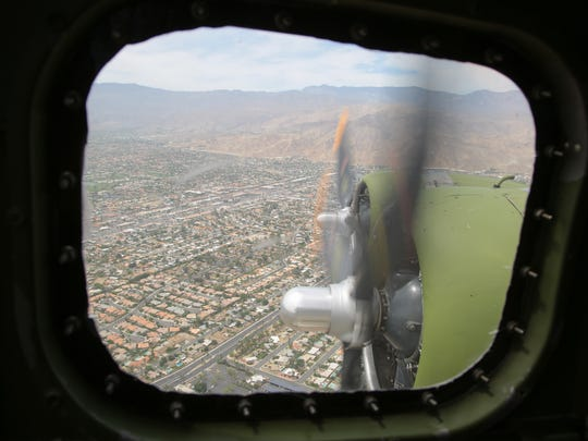 "A view of the propellers on a Boeing B-17 ""Flying Fortress"" as it flew over Palm Springs, Calif., Monday, April 24, 2017.  The plane, the Madras Maiden, is one of only 12 B-17 bombers that remains operational."