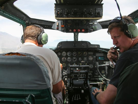 "From left, pilots Scott Maher and Ray Fowler sat in the cockpit of a Boeing B-17 ""Flying Fortress"" as it flew over Palm Springs, Calif., Monday, April 24, 2017.  The plane, the Madras Maiden, is one of only 12 B-17 bombers that remains operational."