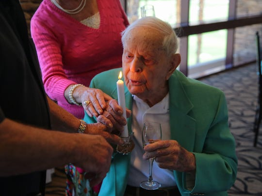Larry Matthew's blows out a candle for his 111th birthday during a celebration held at the Indian Wells Country Club, Monday, May 1, 2017.