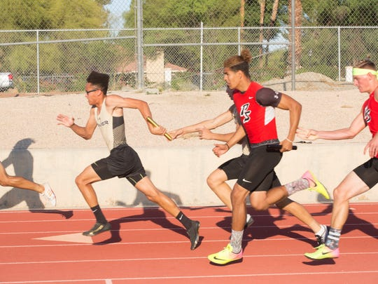 Sprinters complete the first hand off in the boys 4x100 meter relay during the DVL Track Finals, Wednesday, May 3, 2017.