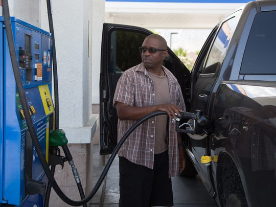 Kenny Davis puts gas into his truck in Palm Springs,