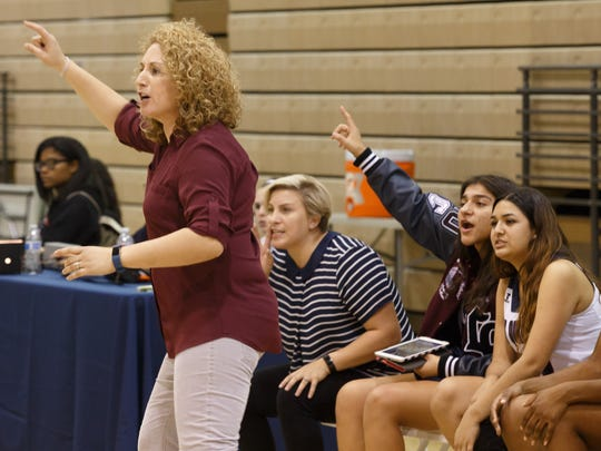 Coach Viveros coaches from the sidelines during a La Quinta girls basketball game against Palm Springs, Feb. 10, 2017.