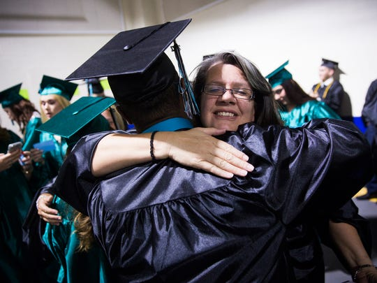 Wetanah Lenardson, a math teacher, hugs one of her students on Friday, May 26, 2017 before the Gulf Coast High School commencement for the class of 2017 at Alico Arena in Estero.