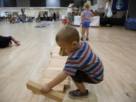 Pax Vega, age 2, plays with blocks from a Hot Purple Energy table at the Palm Springs World Environment Day Celebration, Sunday, June 4, 2017.