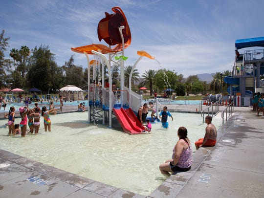 Kids and families play at the Palm Desert Aquatic Center June 6, 2017.
