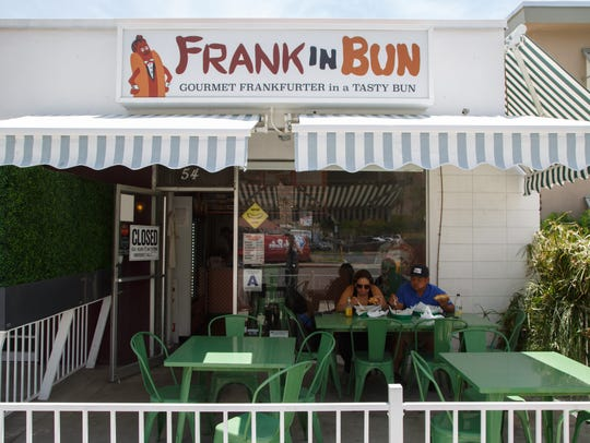 Customers sit outside of Frank in Bun in Palm Springs,