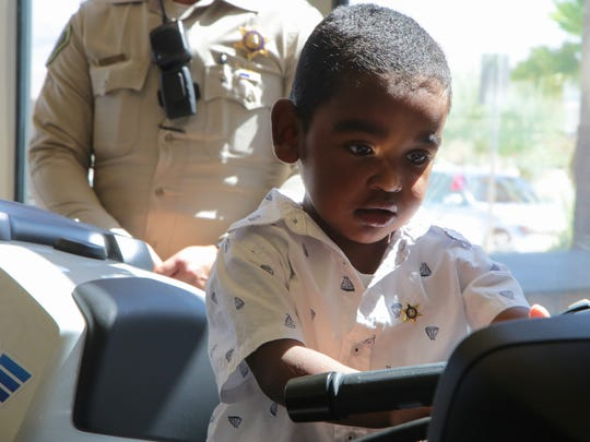 Matthew Castleberry, Jr., sits on a police motorcycle during a media event at the Riverside County Sheriff's Department in Palm Desert, Calif., Tuesday, July 11, 2017.  Sheriff's deputy Alicia Lopez will be donating her kidney to three-year-old Matthew who suffered severe damage to his bladder and kidneys from posterior urethral valves.