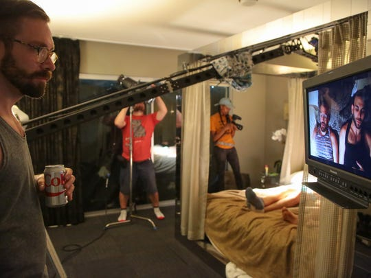Director Kit Williamson checks the framing of a scene