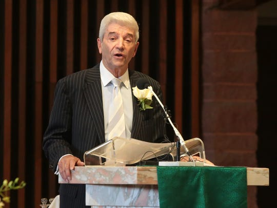Tom Dreesen gives the second reading at the funeral of Barbara Sinatra in Palm Desert, Calif., Tuesday, August 1, 2017.